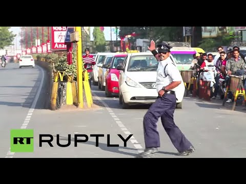 "Crowds gathered to watch Ranjeet Singh 'moonwalk' in busy intersections of Madhya Pradesh's largest city Indore, Saturday. Ranjet Singh, police officer (in Hindi and English): ""Following..."