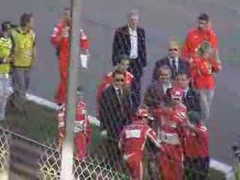 Michael Schumacher waves at the tifosi