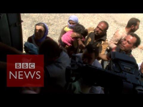 Iraq Crisis - Desperate Yazidis cling on to aid flight- BBC News