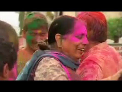 Getting painted at the Holi Festival in India - BBC
