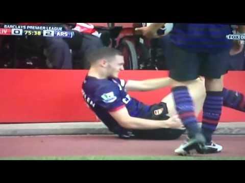 Steven Gerrard tackles  Thomas Vermaelen