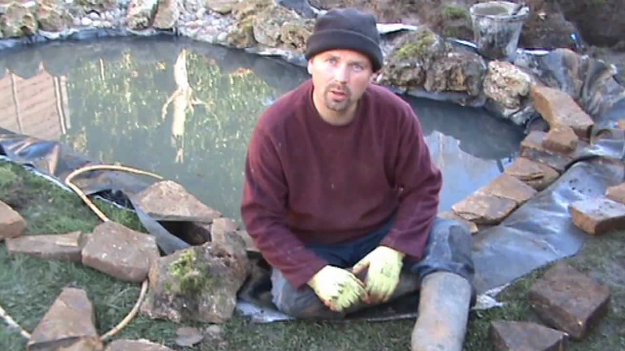 How to build a fish pond part 3 installing the edging for Garden pond do you need a pump