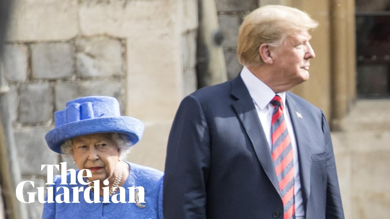 The Queen shows Donald Trump where to walk during the inspection of the guard at Windsor Castle
