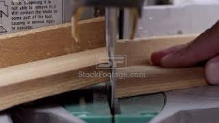 Close up view of miter saw cutting a board and an angle