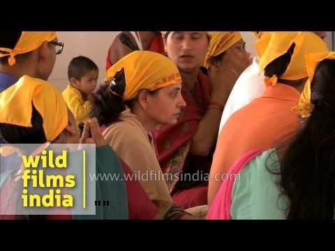 Devotees singing Sai Naath Tere Hazaaron Haath