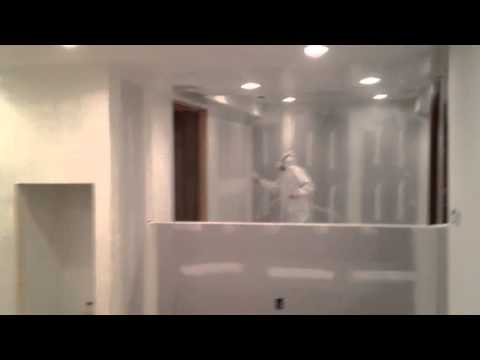 Finishing basement - spraying primer on new drywall