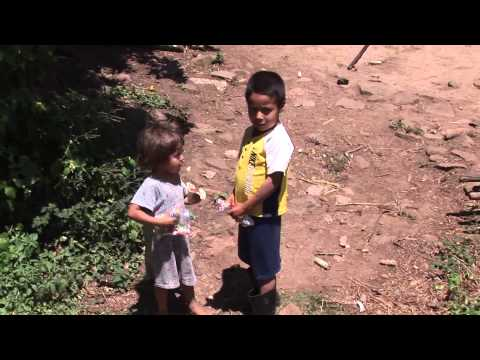 Americans Giving Food Bags to the Poor in the Mountains of Honduras