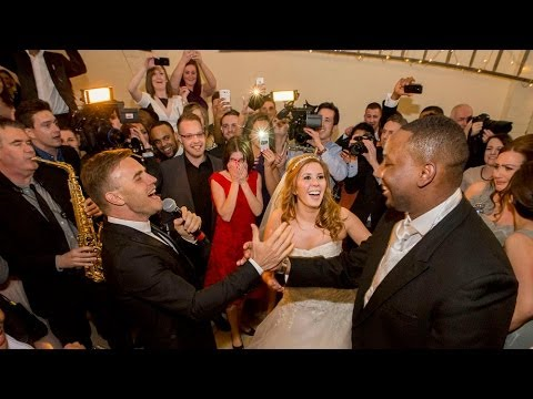 http://www.nigelharper.com An AV of the ensuing pandemonium at Louise & Marks wedding when Gary Barlow walked in singing, just after their first dance. The w...