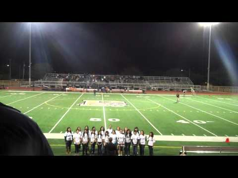 Douglas High School Choir singing at football game
