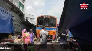 WONDERFUL THAI SRT MAEKLONG RAILWAY FOLDING UMBRELLA MARKET.