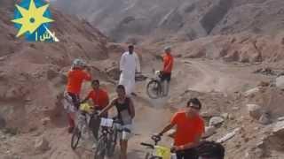 بالفيديو: سباق الدراجات وسط الجبال وتسلقها يبهر الأجانب المشاركين بمهرجان أمواج دهب السبعة