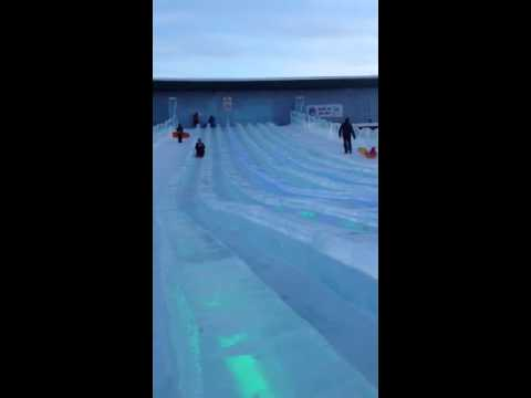 Scarlett and mom sledding at ice park