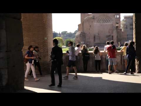 Tourists walking around taking pictures at the Colosseum circa May 2012, Rome, Italy.