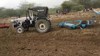 Eicher 557 tractor demo with 2 harrow in the field