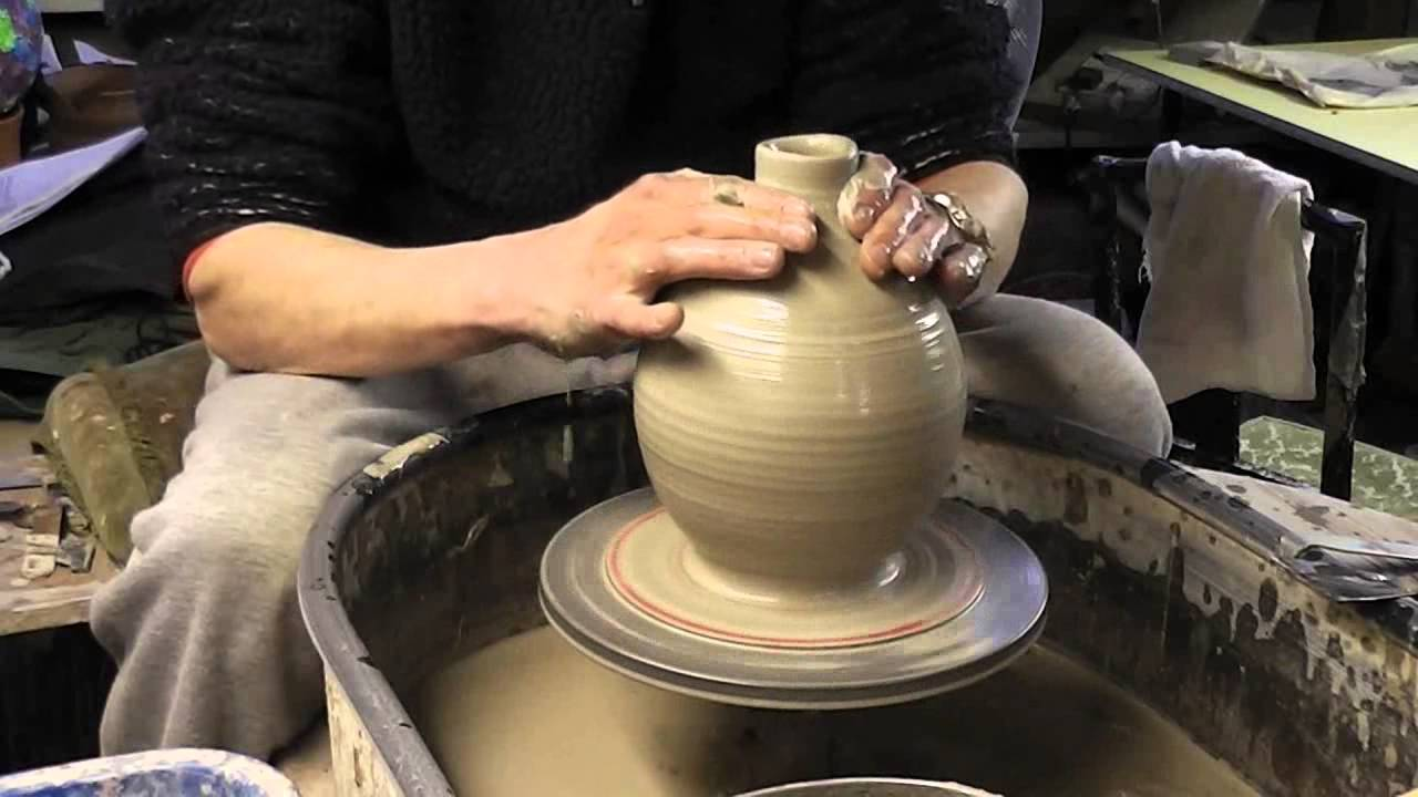 Throwing A 4 Holed Prototype Clay Pottery Bird Feeder On