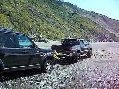 Toyota Tacoma 4x4 Pulling Out Land Rover