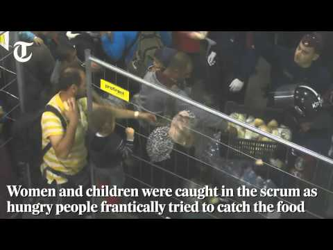 Video Police threw food for immigrants digusting