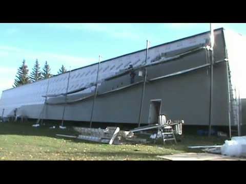 5X speed - Installing Fiber Cement siding on the Calgary Frank McCool Arena