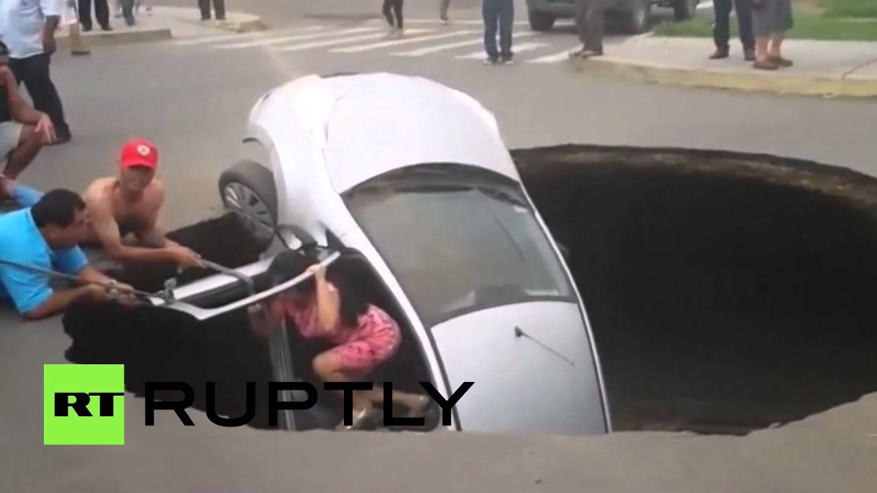 Giant sinkhole swallows car with family still inside in Peru
