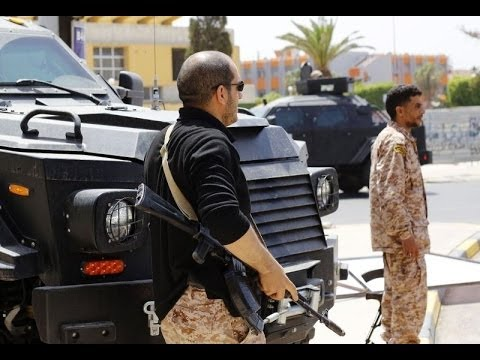 Libya PM's home attacked, US sends warship