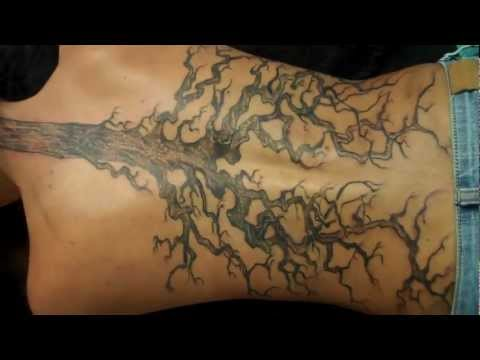 freehand tree roots back  and neck tattoo in progress