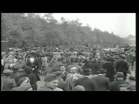 Welsh Guards parade and a crowd gathers to celebrate Victory in Europe Day London...HD Stock Footage