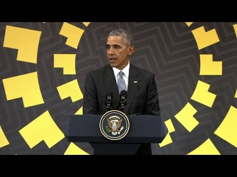 Obama on Trump: Take a wait-and-see approach