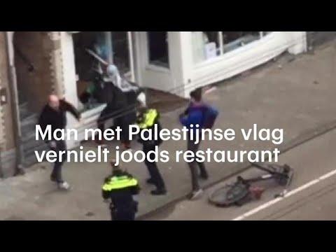 Man met Palestijnse vlag slaat ruiten joods restaunt in - RTL NIEUWS