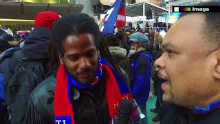 Artist Paul Beaubrun at the Rally against President Trump in Time Squares New York