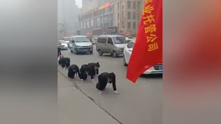 Viral video: Chinese company makes staff crawl on a road as punishment