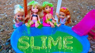 Elsa and Anna toddlers slime in the pool