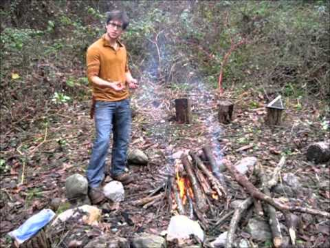 Making a fire with wet wood during survival training weekend
