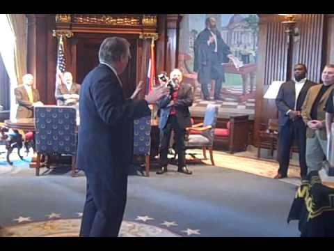 Gov. Jay Nixon greets Missouri football team in his office