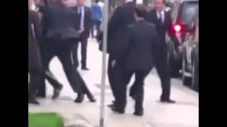 David Cameron pushed by protester in Leeds