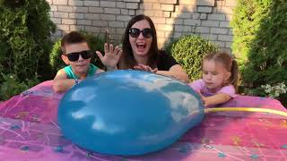Kids and Mommy playing with Giant Water Balloons by JoyJoy Lika