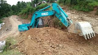 Road Show, Blue Excavator Earth Loading.