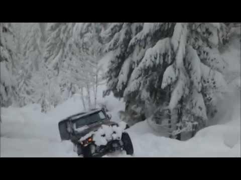 Jeep Wrangler in Deep Snow Pacific Northwest Cascades of Oregon