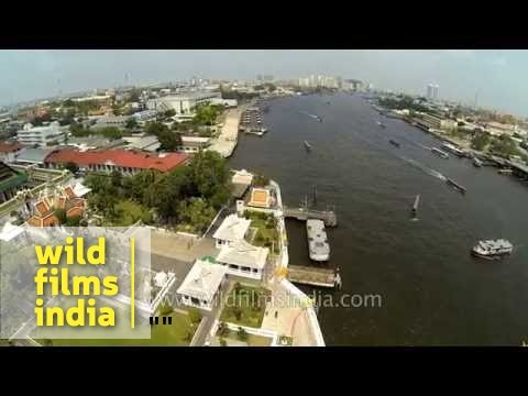 Aerial shots of Wat Arun Temple and Chao Phraya River – Thailand