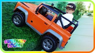 New Power Wheels Climbing Up Dirt Hill, Land Rover Defender Race - SuperBaby Colors