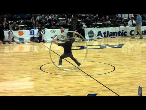 Ring man doing tricks in huge hula hoop ring