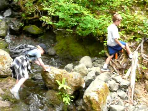Boys taking the 'easy way' across a mountain stream in Washington State