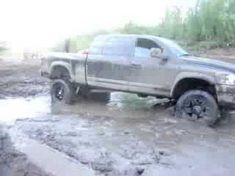 Trucks stuck in mud hole