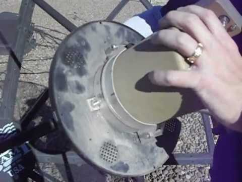 Changing the polarization on a satellite dish feedhorn.