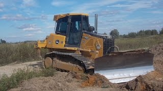 John Deere 750J stripping topsoil part 1