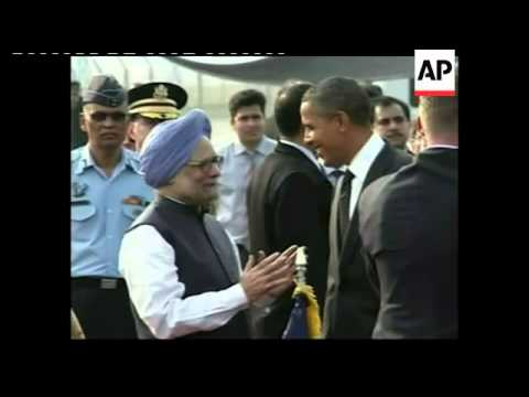 US President meets Prime Minister Singh at airport
