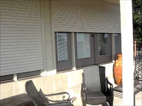 Security shutters dallas french doors motorized rolling for Rolling french doors