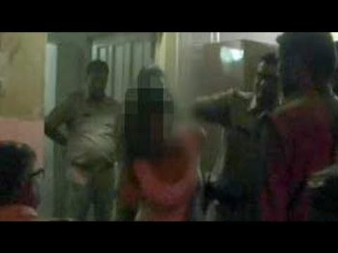 Cop caught on camera slapping a girl at police station