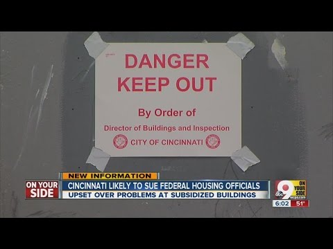 After flooding displaces residents, city leaders threaten legal action against HUD