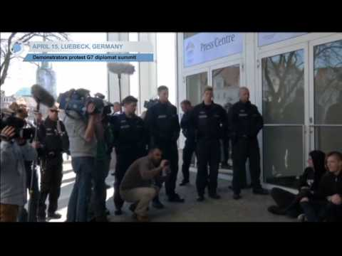 Anti-G7 Protesters Stage Sit-In: Protesters stage 'anti-capitalist' sit-in protest outside G7 venue