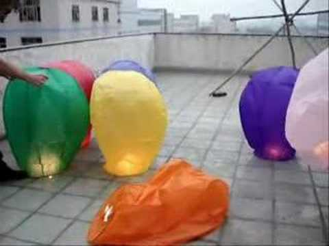 Mix Colored Sky Lanterns taking off in a group